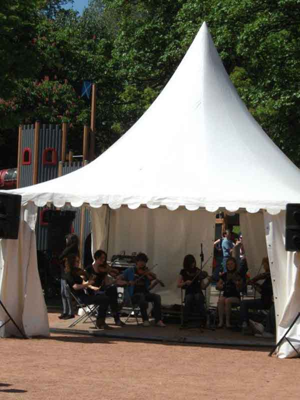 musicians playing in a marquee hire at a summer event